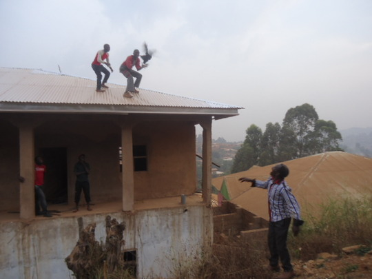 Carpenter receiving a chicking after roofing.