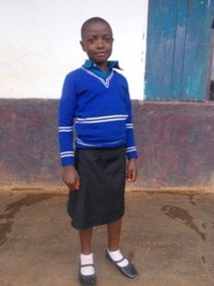 Melvis  is now very happy  attending school