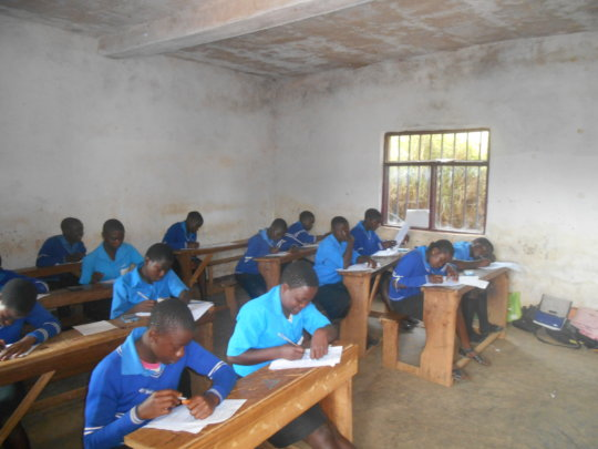 Students busy writing their exams.
