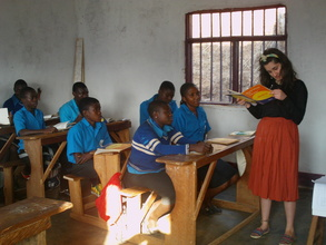 Hannah our volunteer teaching English to the OVCs
