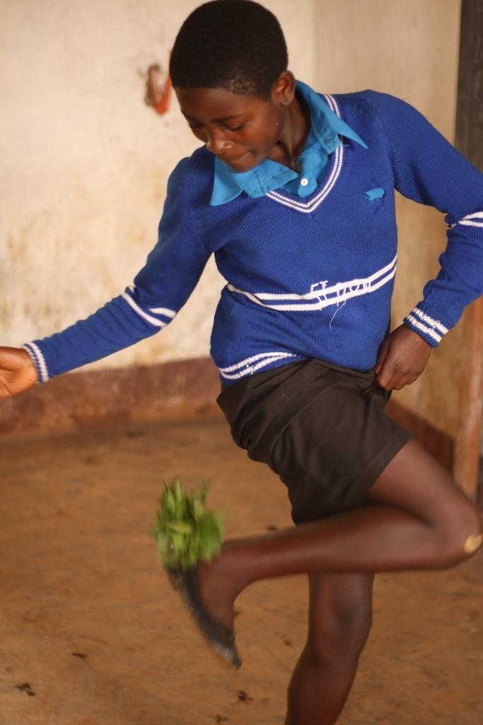An orphaned enjoying playing during short break