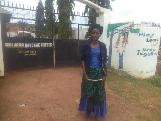 Lois outside Malaika Daycare Center