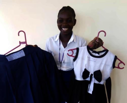Melania with clothing she designed and created