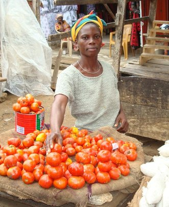 Loan client Janet sells tomatoes in Nsawam market