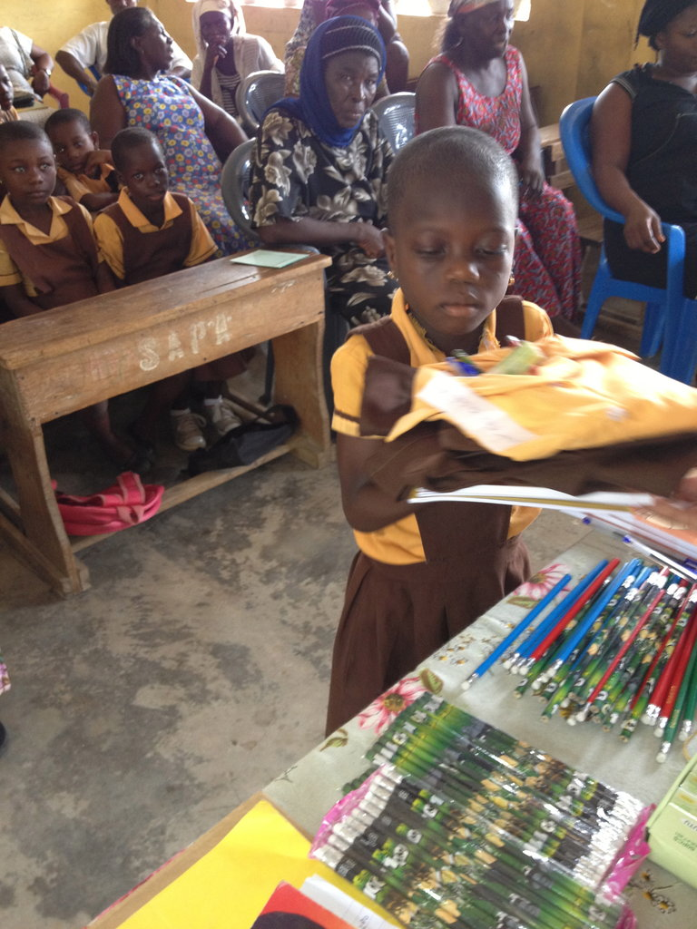Student receives new uniform and school supplies