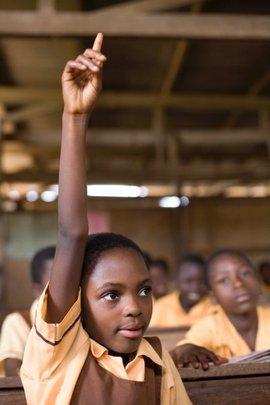 Scholarship Student Raising Hand