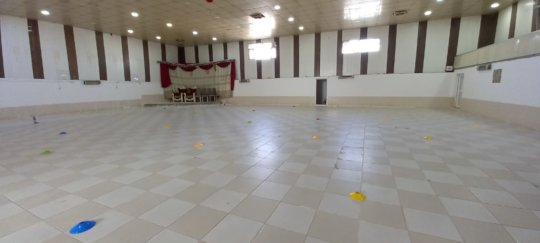 Our fitness classes take place in a wedding hall!