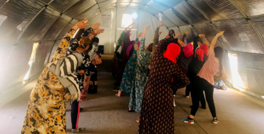 Refugees exercising during OPM fitness classes