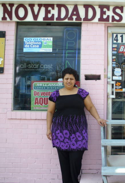 Alejandra in front of HER store