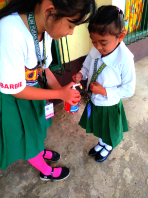 A Mini Nurse assists a young student