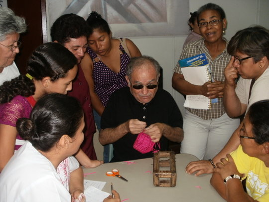 Dimas sharing basket making skills