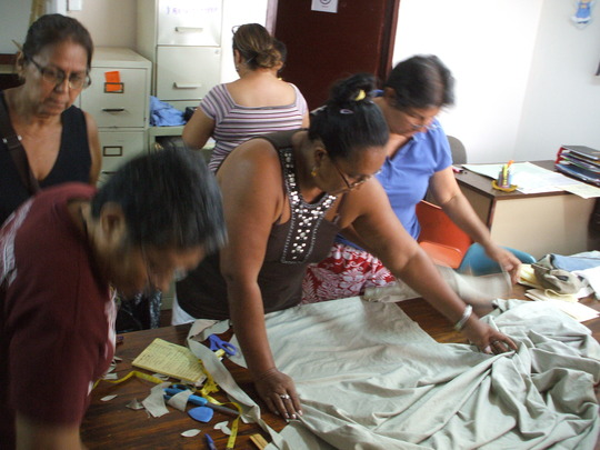 Learning Center volunteers making the garments