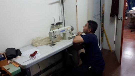 Diddman fixing sewing machines