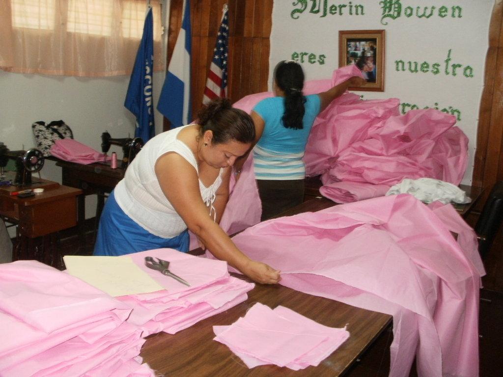 Suyen & Petronila working on hospital sheets