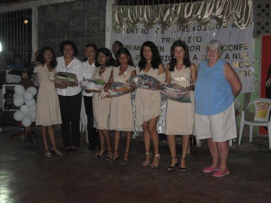 Lynda with the class graduates