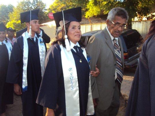 Petronila receiving her high school diploma