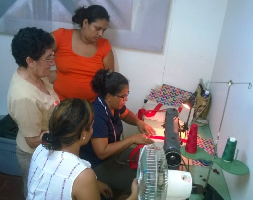 Teacher Petronila demonstrating the techniques