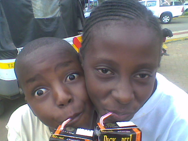 Sarah and Joseph happy after participating in one of the junior assemblies debate, Children discuss issues affecting them and seek solutions, a drink activities them more.