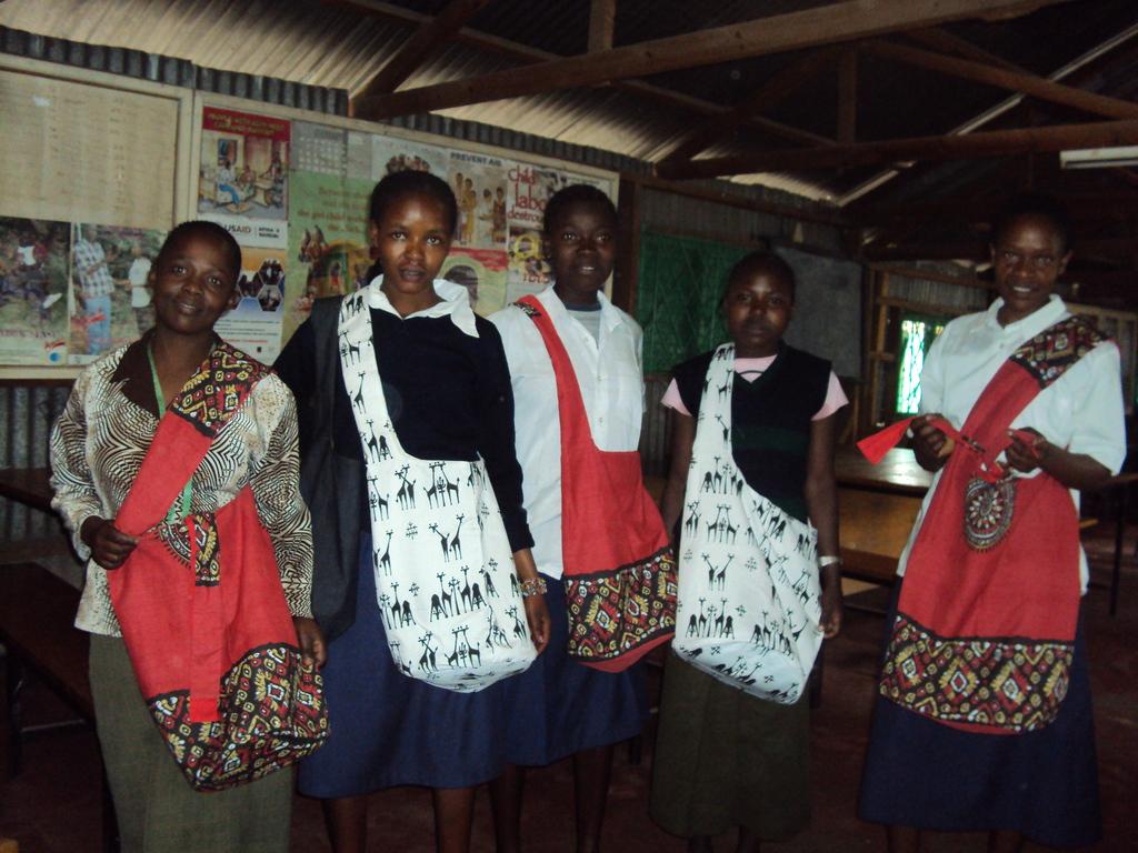 HTM girls display their Kenyan made hand bags