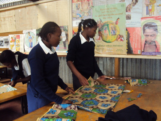 Teenage mums in class for tailoring