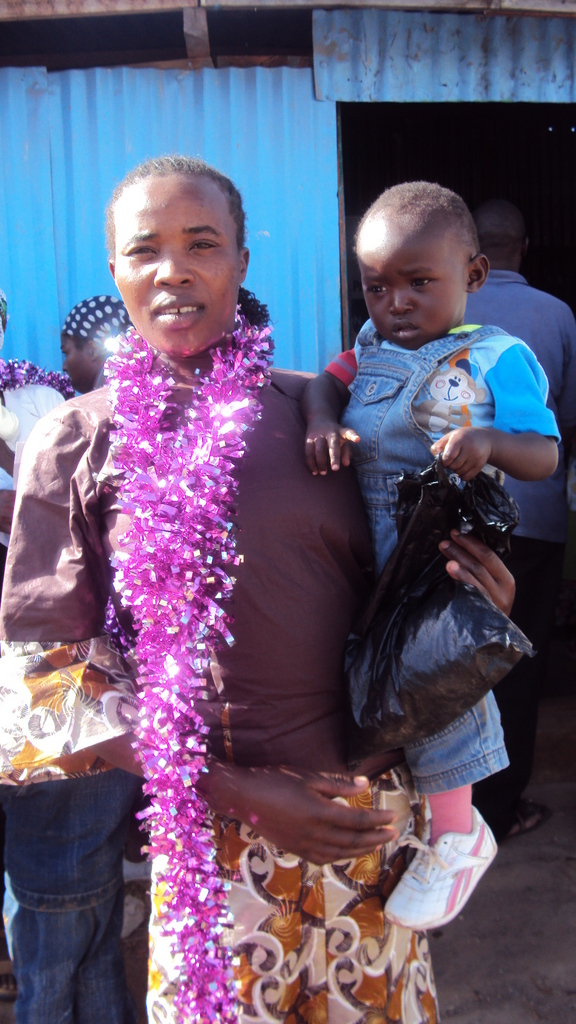 A teen mum graduate with her baby