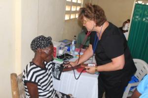 Nurse Deborah taking vital signs.