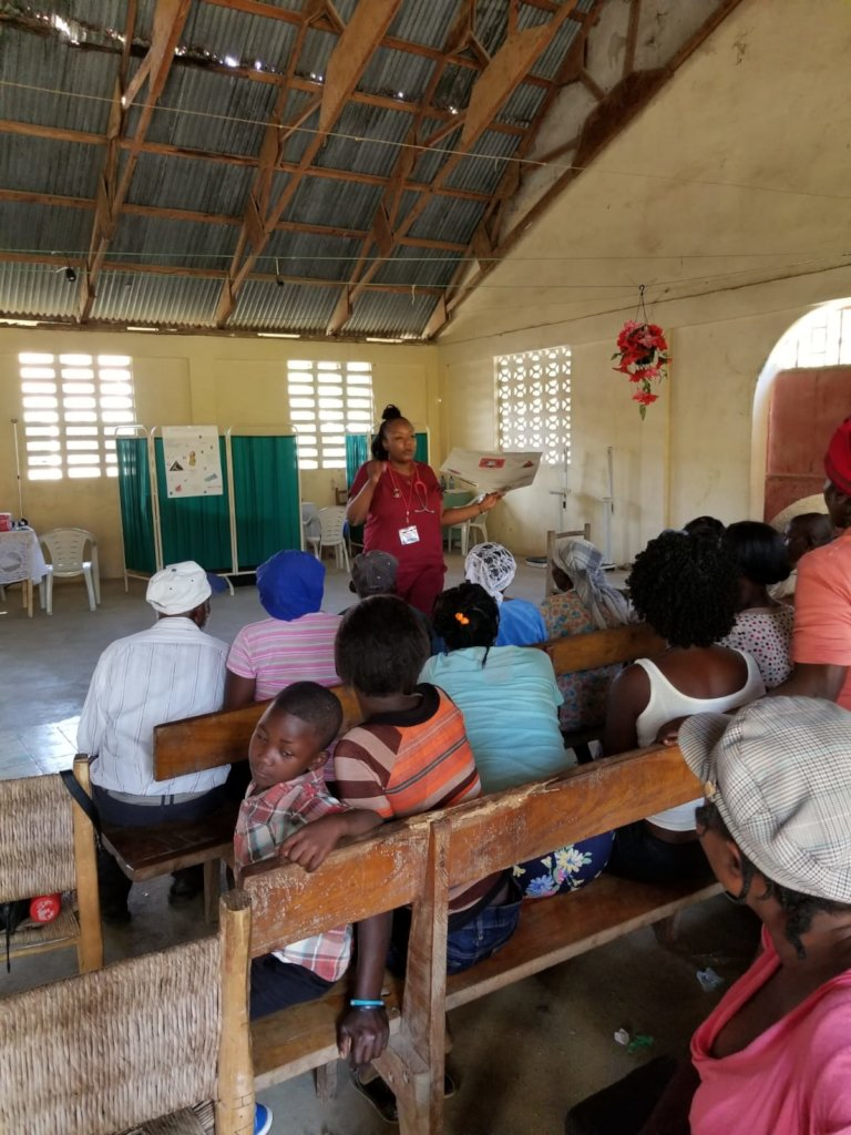 Nurse Christine running an educational conference