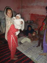 A young  girl with her siblings at home