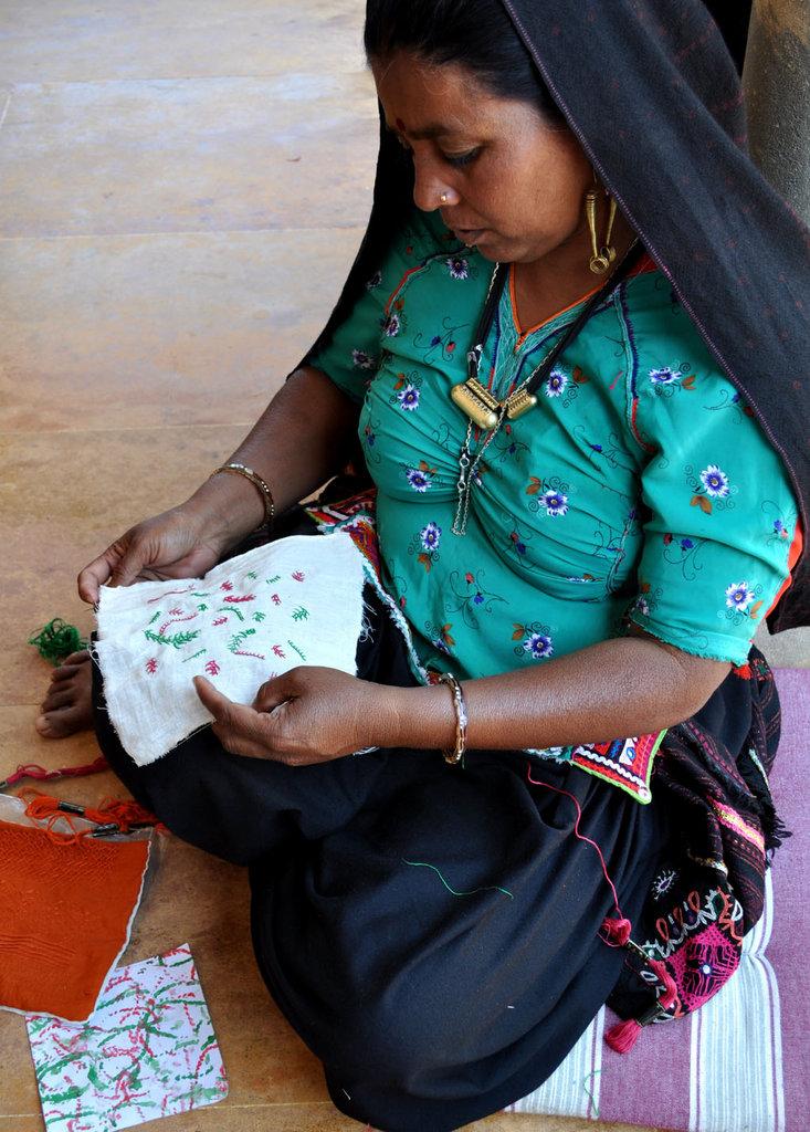 Jasiben contemplates design in embroidery