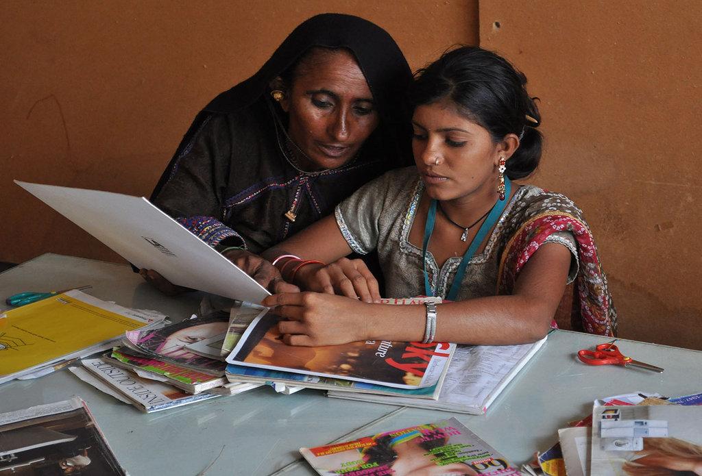 Sajana helping Hina think out a theme
