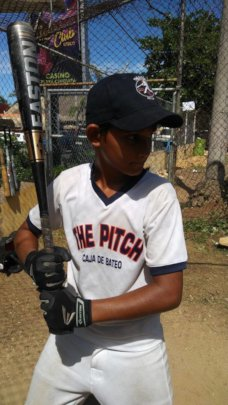 Fully outfitted youth in the Batting cage