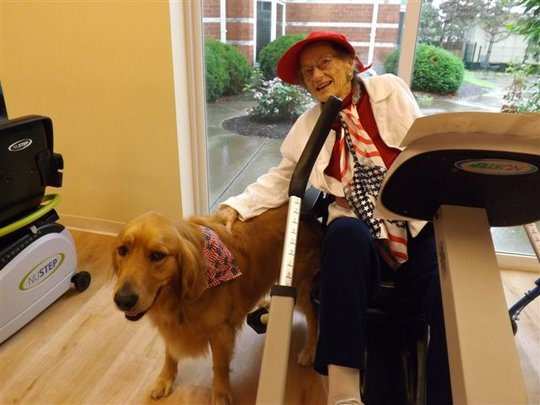 Resident with Gates, the Cedar Village dog