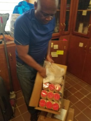 Jacques, our chef, receiving shipped-in supplies