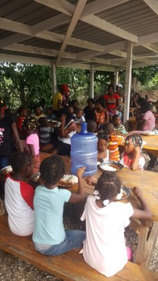 Families and friends enjoying a meal together