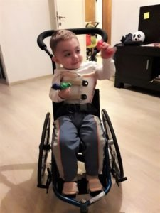 Alex Nicholas plays in his tiny wheelchair