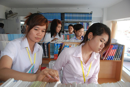 Mealea (right) at her university library