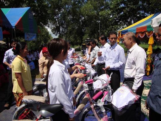 Girls receiving their new bikes