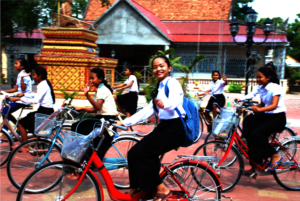 Bright and shining orphan girls on their bikes.