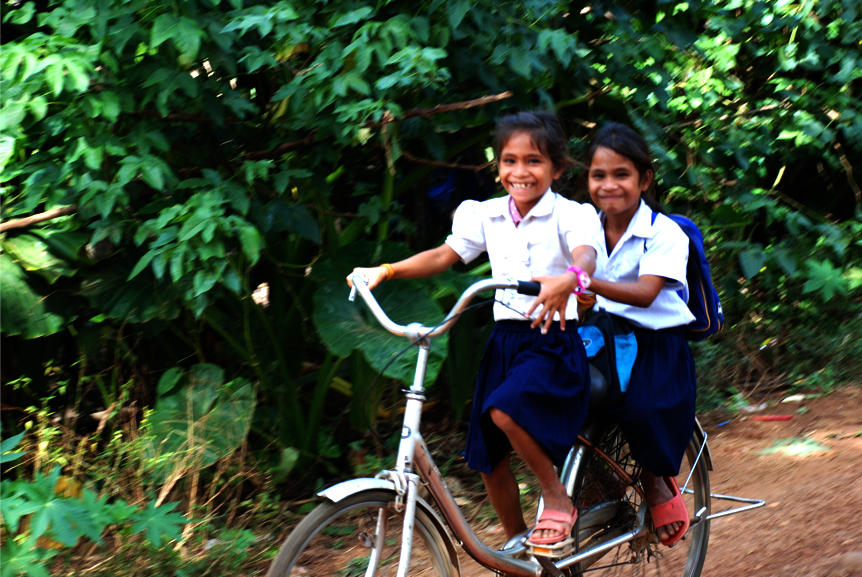 Children of poor families often share their bikes!
