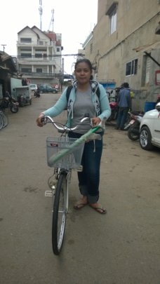 Meas receiving her bicycle.