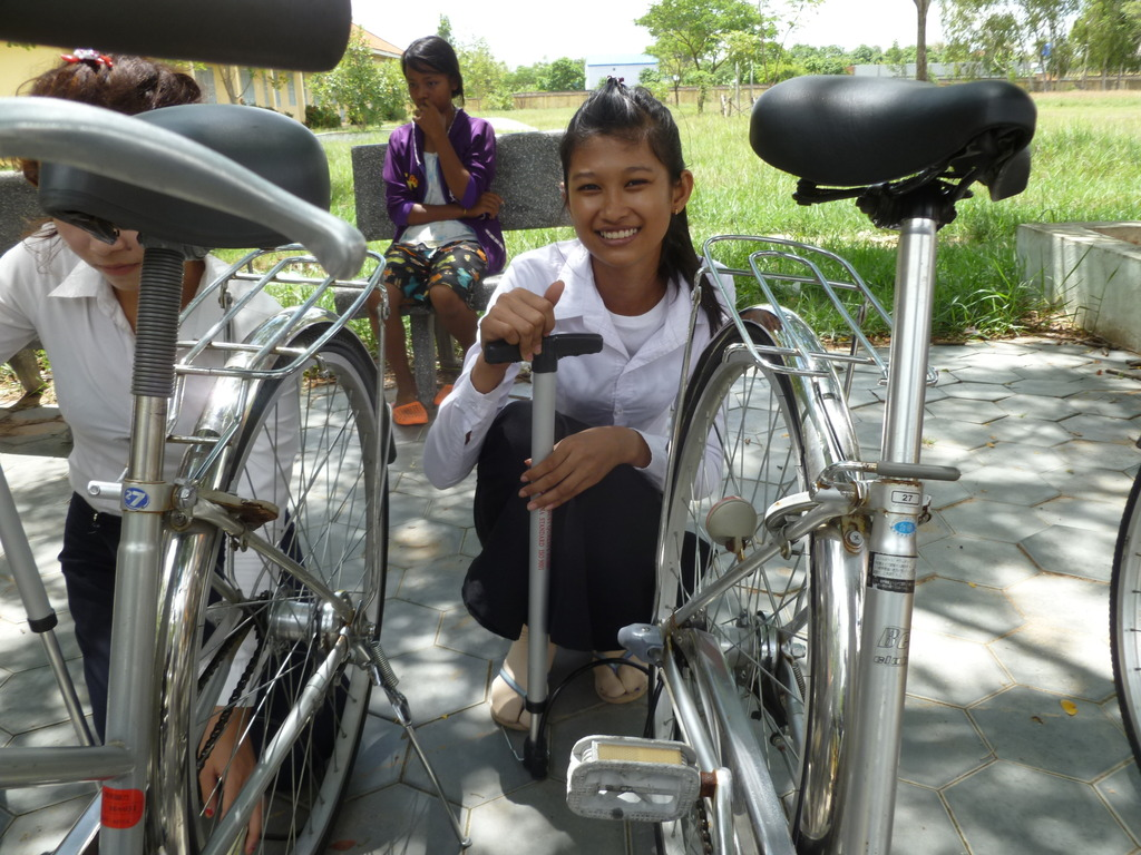 Chea tries out her new bike and pump