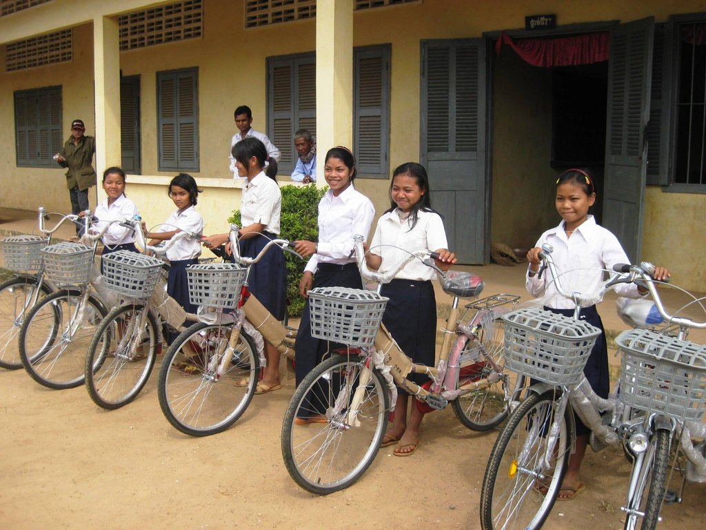 Girls in rural Mondulkiri receive their new bikes