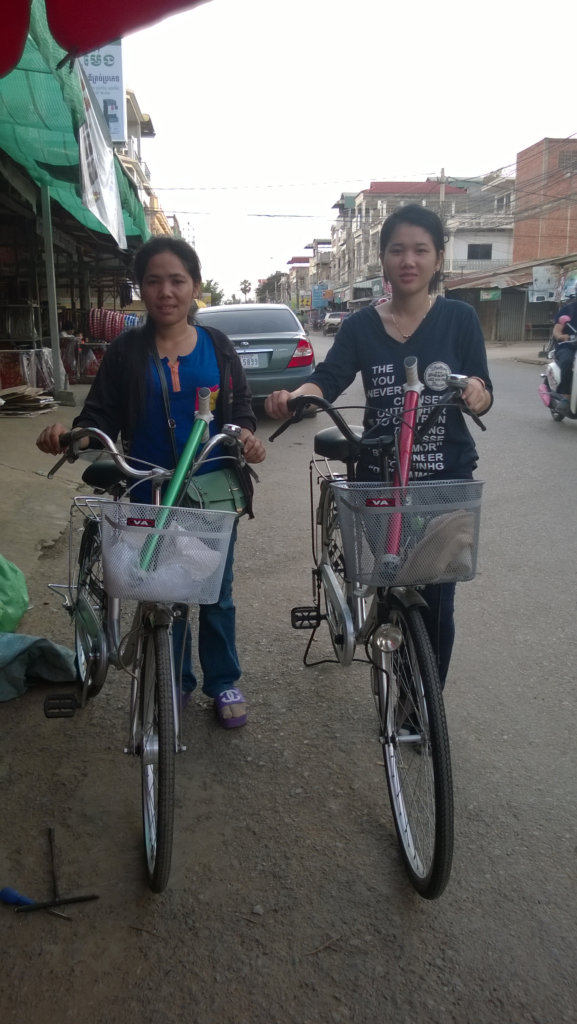 Ratana and her friend with their bikes