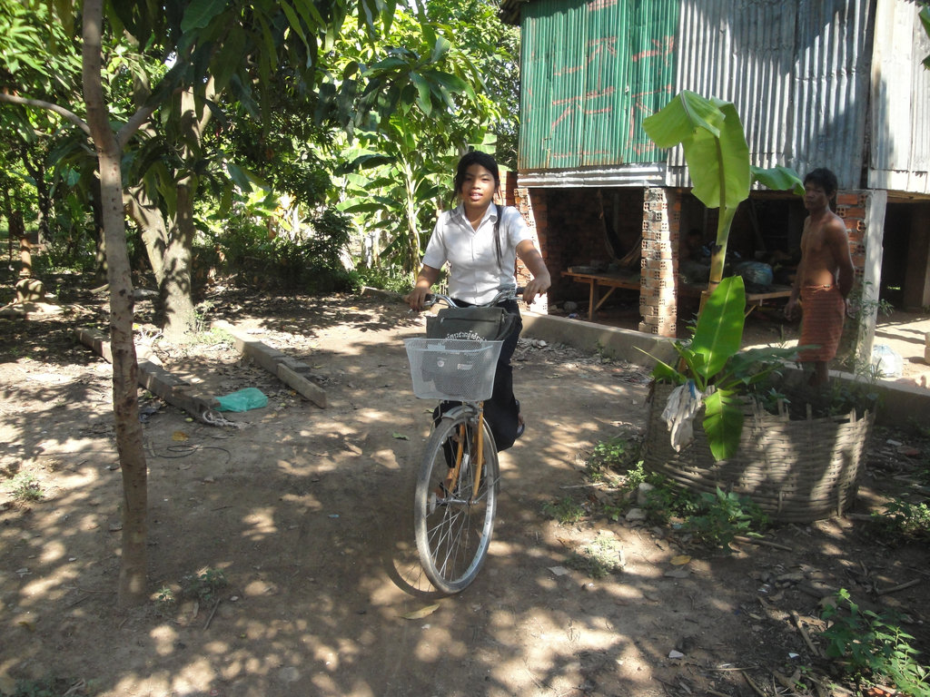 Soline next to her hut in Andong village
