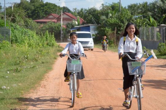Sreykat and Vattey riding their new bikes!