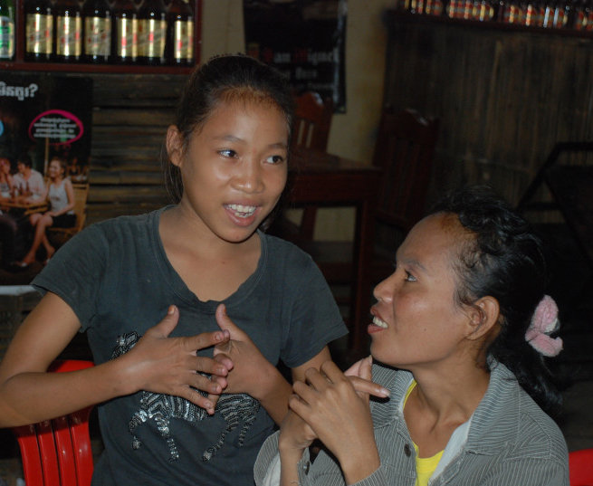 Thida chats with an NFE classmate at Goat Soup