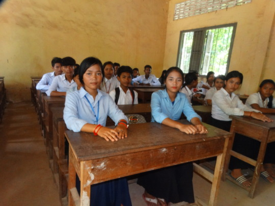 Theara in her classroom with classmates.