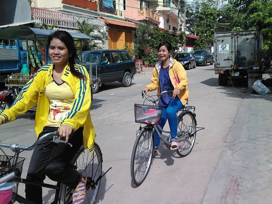 Mealea (left) on her Lotus Pedals bike