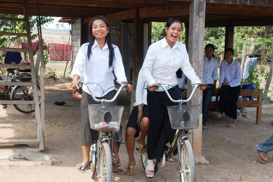 Girls on bikes in Banteay Meanchey