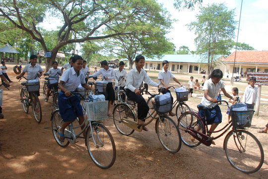 Riding to school in Phnom Kravanh!